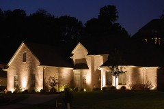 custom-designed architectural lighting illuminating a brick house